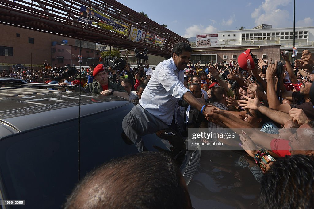 Nicolas Maduro, candidate of PSUV greets the people after vote on April 14, 2013 in Caracas, Venezuela.