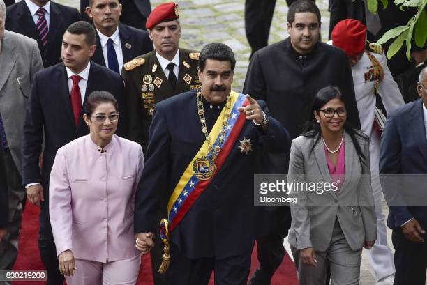 Nicolas Maduro president of Venezuela center Cilia Flores First Lady of Venezuela left and Delcy Rodriguez president of the Constituent Assembly...