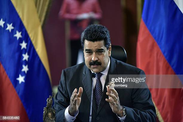Nicolas Maduro president of Venezuela center speaks to the media after Igor Sechin chief executive officer of Rosneft PJSC not pictured and Eulogio...