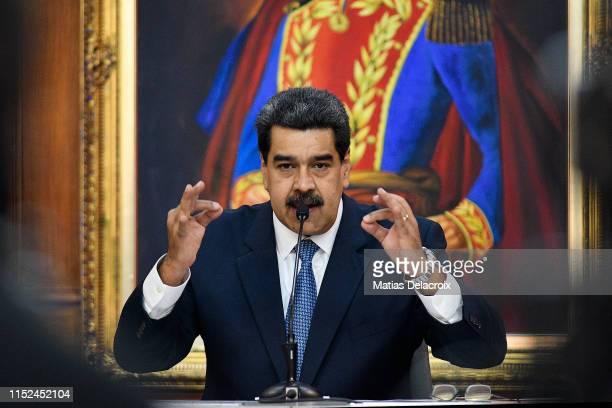 Nicolas Maduro President of Venezuela gestures as he speaks during the Simon Bolivar Journalism National Award ceremony at Palacio de Miraflores on...