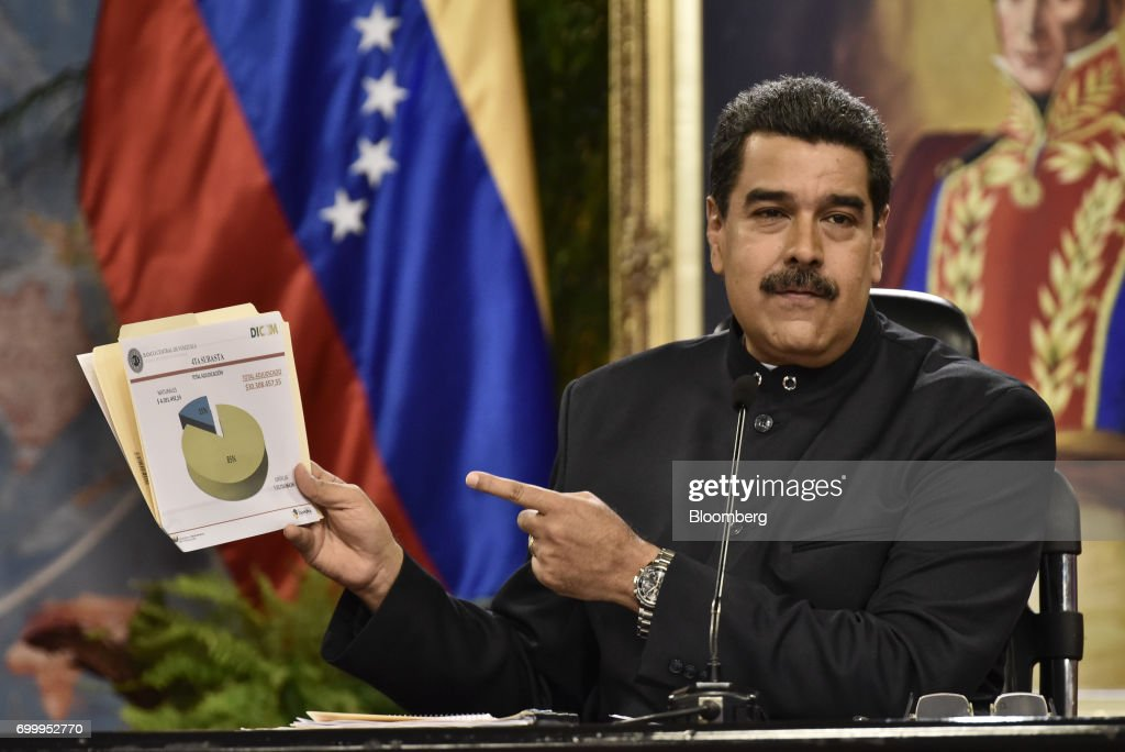 Nicolas Maduro, president of Venezuela, holds up a chart during a press conference in Caracas, Venezuela, on Thursday, June 22, 2017. Since June 15, Maduro has named four new ministers: Mirelys Contreras as Prisons Minister; Ana Reyes as Culture Minister; Kyra Andrade as Communes Minister; Yamilet Mirabal Calderon as Indigenous Peoples Minister; and Samuel Moncada as foreign minister. Photographer: Carlos Becerra/Bloomberg via Getty Images