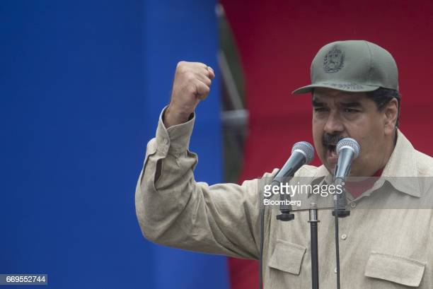 Nicolas Maduro president of Venezuela speaks during a ceremony with Militia members in Caracas Venezuela on Monday April 17 2017 Maduro approved a...