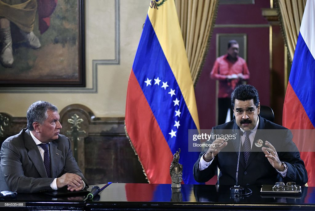Nicolas Maduro, president of Venezuela, speaks to the media, after Igor Sechin, chief executive officer of Rosneft PJSC, left, and Eulogio del Pino, president of Petroleos de Venezuela SA (PDVSA), not pictured, signed natural gas deals in Caracas, Venezuela, on Thursday, July 28, 2016. The agreements included a deal for Rosneft to participate in the Mariscal Sucre natural gas project. Photographer: Carlos Becerra/Bloomberg via Getty Images