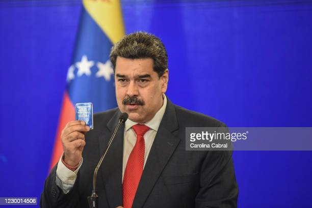 Nicolas Maduro President of Venezuela speaks to the media to give a balance of the recent Parliamentary elections whie showing a miniature of the...