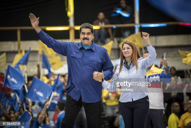 Nicolas Maduro Venezuela's president and Cilia Flores Venezuela's first lady gesture during a rally in Caracas Venezuela on Wednesday Feb 7 2018...