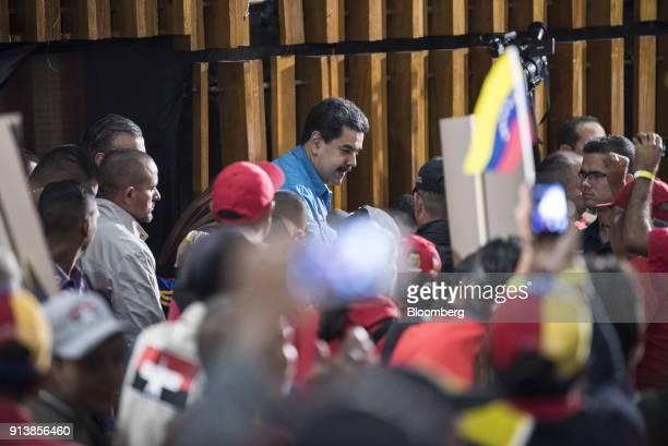 Nicolas Maduro Venezuela's president center greets attendees during a Tupamaro political party rally in Caracas Venezuela on Saturday Feb 4 2018...