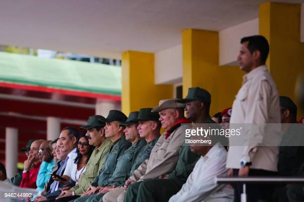 """Nicolas Maduro, Venezuela's president, center left, watches members of Venezuela's civilian militia during a military parade at a """"Day Of National..."""