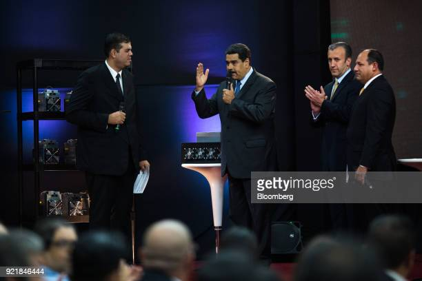 Nicolas Maduro Venezuela's president center speaks as Tareck El Aissami Venezuela's vice president second from right Hugbel Roa minister for science...