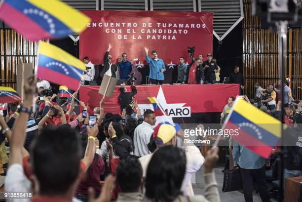 Nicolas Maduro Venezuela's president center waves to attendees during a Tupamaro political party rally in Caracas Venezuela on Saturday Feb 4 2018...