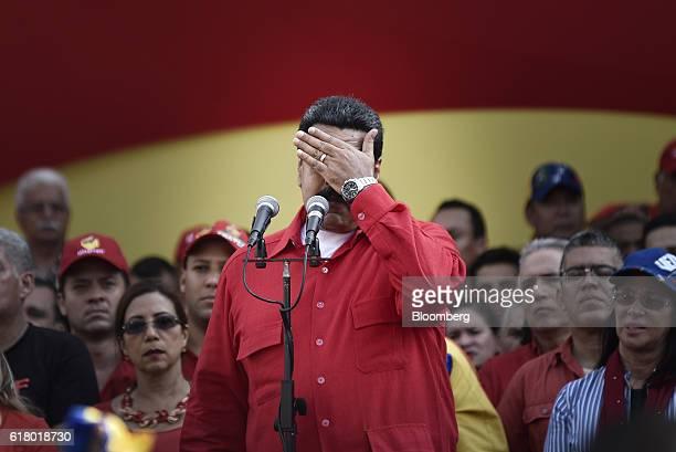 Nicolas Maduro Venezuela's president gestures while addressing progovernment supporters in Caracas Venezuela on Tuesday Oct 25 2016 Venezuela's armed...