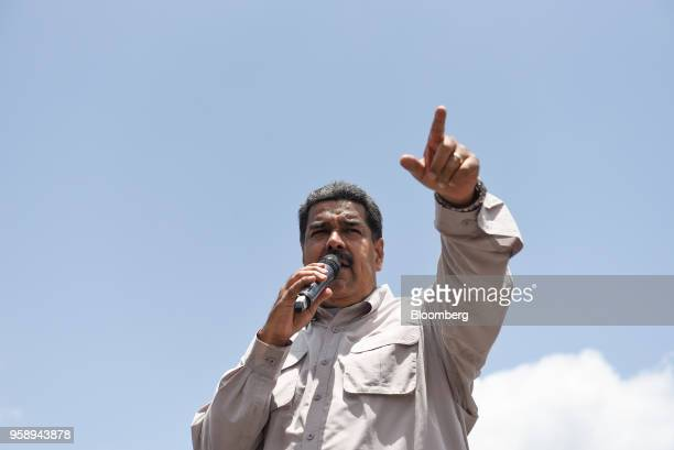 Nicolas Maduro Venezuela's president gestures while speaking during a campaign rally in Charallave Miranda state Venezuela on Tuesday May 15 2018...