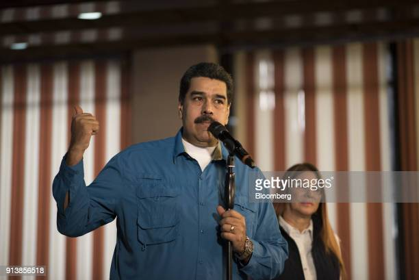 Nicolas Maduro Venezuela's president left address members of the media as Cilia Flores first lady of Venezuela listens during a press event in...
