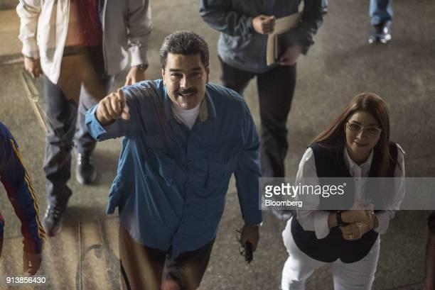 Nicolas Maduro Venezuela's president left and Cilia Flores first lady of Venezuela arrive for a Tupamaro political party rally in Caracas Venezuela...