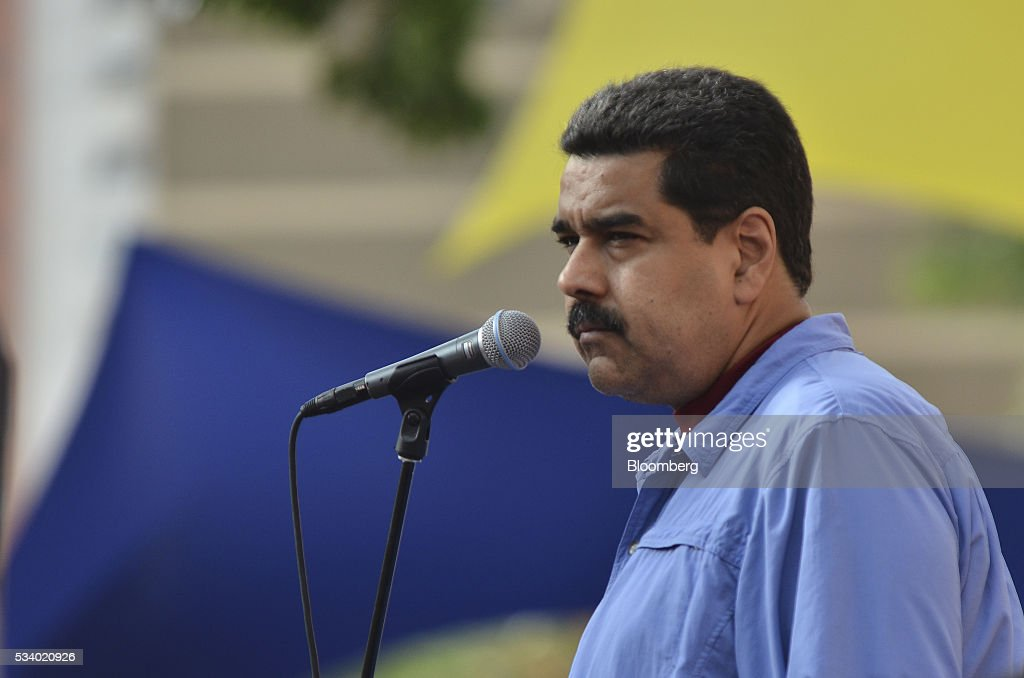 Nicolas Maduro, Venezuela's president, pauses while speaking during a rally for women and peace at the Miraflores Palace in Caracas, Venezuela on Tuesday, May 24, 2016. On Tuesday, hundreds of women took to the streets in a show of support for President Maduro and against what they called the violent demonstrations by the opposition. Photographer: Carlos Becerra/Bloomberg via Getty Images