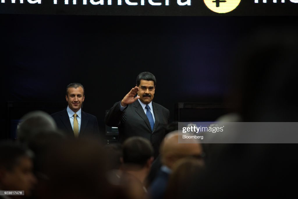 Nicolas Maduro, Venezuela's president, right, and Tareck El Aissami, Venezuela's vice president, arrive for the Petro cryptocurrency launch event in Caracas, Venezuela, on Tuesday, Feb. 20, 2018. Maduro launched Petro to use as a new alternative payment system amid hyperinflation and the eroding bolivar. Photographer: Wil Riera/Bloomberg via Getty Images
