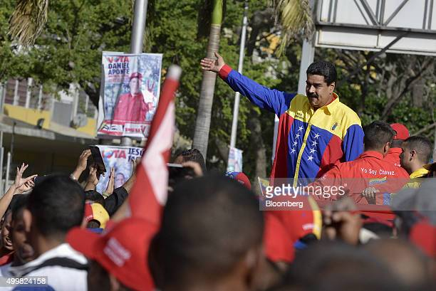 Nicolas Maduro Venezuelas president waves while arriving at a campaign rally for progovernment candidates in Caracas Venezuela on Thursday Dec 3 2015...