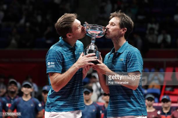Nicolas Mahut and Edouard Roger-Vasslin of France pose with the trophy after winning their men's doubles final against Nikola Mektic and Franko...