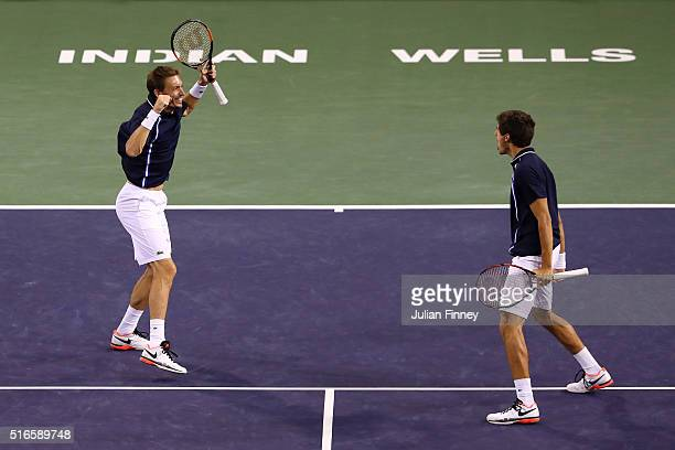 Nicolas Mahut and PierreHugues Herbert of France celebrate defeating Jack Sock of USA and Vasek Pospisil of Canada in the doubles final during day...