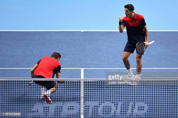 Nicolas Mahut and Pierre-Hugues Herbert of France celebrate in their doubles match against Kevin Krawietz of Germany and Andreas Mies of Germany...