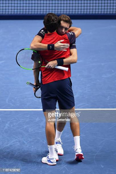 Nicolas Mahut and Pierre-Hugues Herbert of France celebrate match point in their doubles match against Kevin Krawietz of Germany and Andreas Mies of...