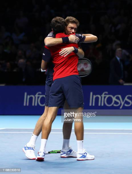 Nicolas Mahut and Pierre-Hugues Herbert of France celebrate championship point in their doubles final match against Raven Klaasen of South Africa and...