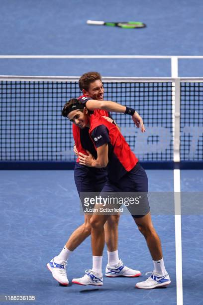Nicolas Mahut and Pierre-Hugues Herbert of France celebrate victory after their doubles final match against Raven Klaasen of South Africa and Michael...