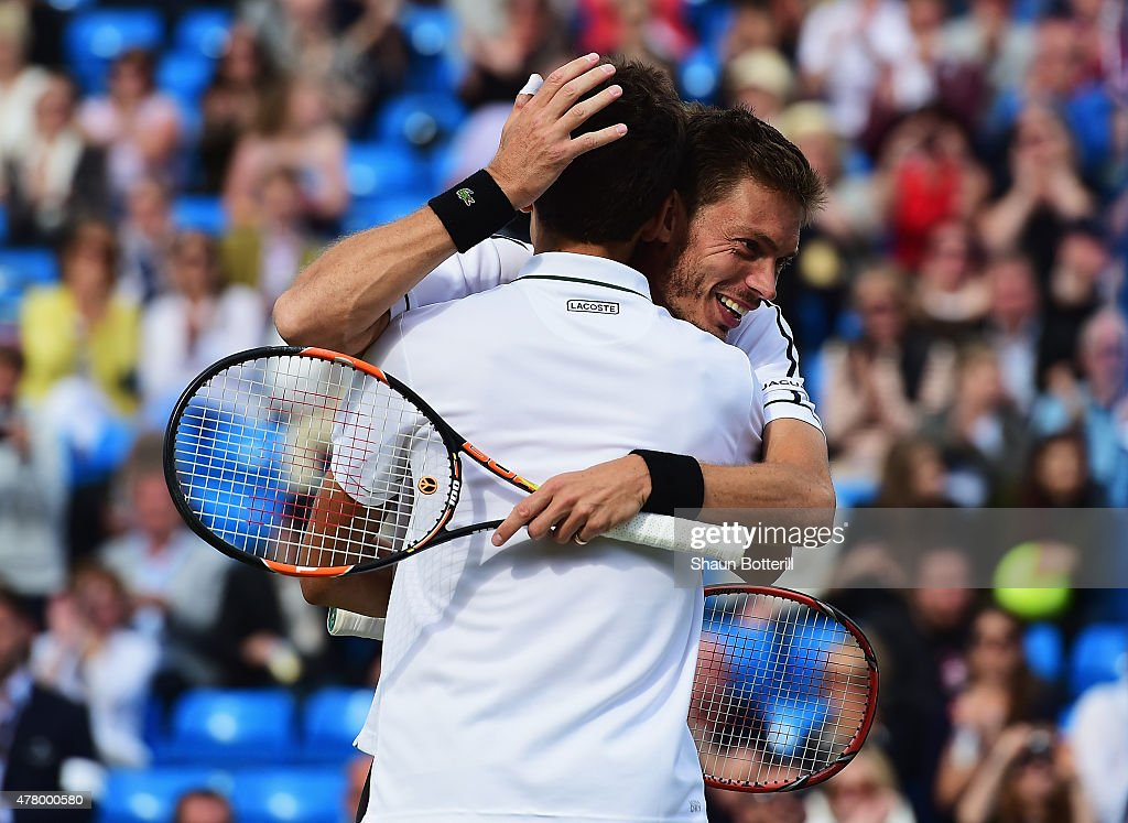 Nicolas Mahut (R) and Pierre-Hugues Herbert of France celebrate victory against Marcin Matkowski of Poland and Nenad Zimonjic of Serbia after the men's doubles final during day seven of the Aegon Championships at Queen's Club on June 21, 2015 in London, England.