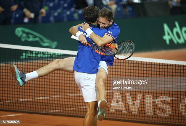 Nicolas Mahut and PierreHugues Herbert of France celebrate winning the doubles match against Serbia on day two of the Davis Cup World Group tie...