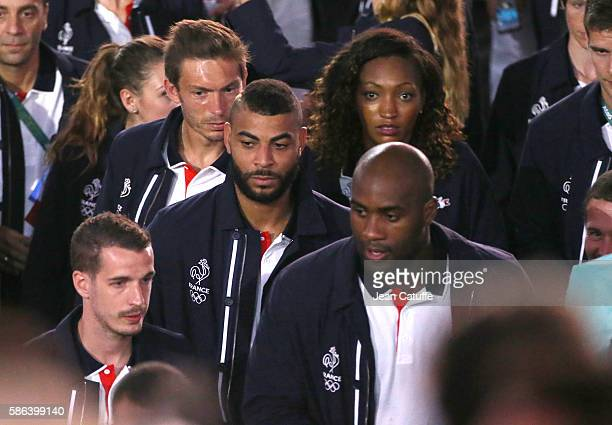 Nicolas Mahut Earvin N'Gapeth Teddy Riner of France attend the opening ceremony of the 2016 Summer Olympics at Maracana Stadium on August 5 2016 in...