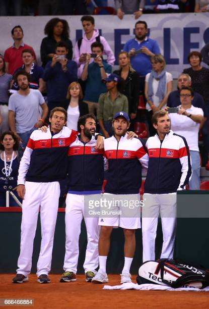 Nicolas Mahut Jonathan Eysseric Lucas Pouille and Julien Benneteau of France celebrate their victory against Great Britain on day 3 of the Davis Cup...