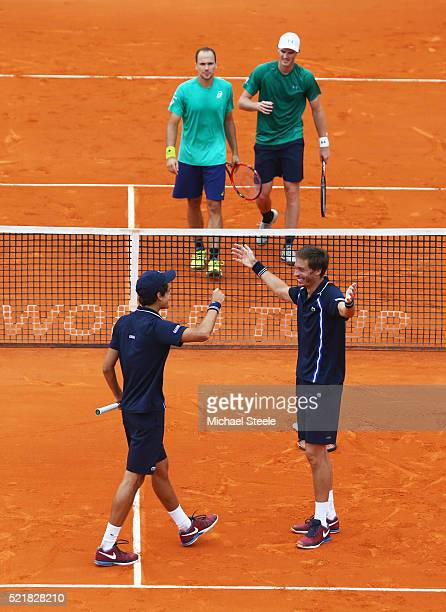 Nicolas Mahut of France and Pierre Hugues Herbert of France celebrate victory over Bruno Soares of Brazil and Jamie Murray of Great Britain in the...