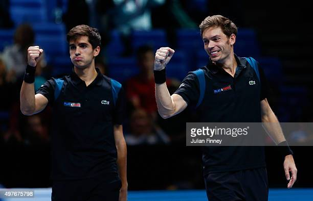 Nicolas Mahut of France and PierreHugues Herbert of France celebrate victory in their men's doubles match against Marcin Matkowski of Poland and...
