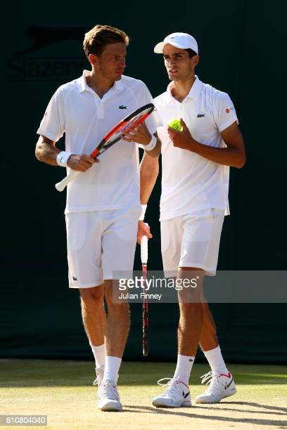 Nicolas Mahut of France and PierreHugues Herbert of France in discussion during the Gentlemen's Doubles second round match against Marcus Willis of...