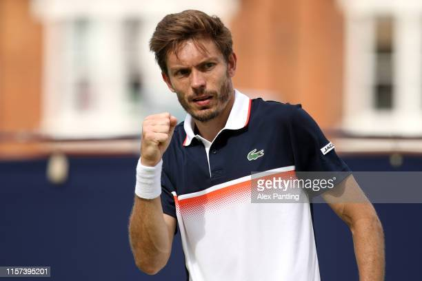 Nicolas Mahut of France celebrates a point during his Quarter-Final Singles Match against Gilles Simon of France during day Five of the Fever-Tree...