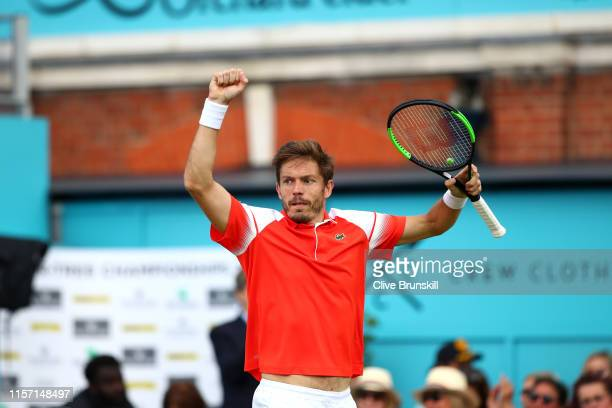 Nicolas Mahut of France celebrates match point during his Second Round Singles Match against Stan Wawrinka of Switzerland during day Four of the...