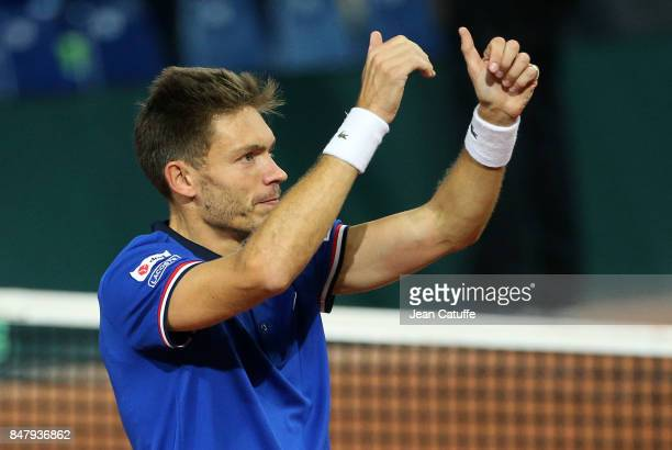 Nicolas Mahut of France celebrates winning the doubles match against Serbia on day two of the Davis Cup World Group tie between France and Serbia at...