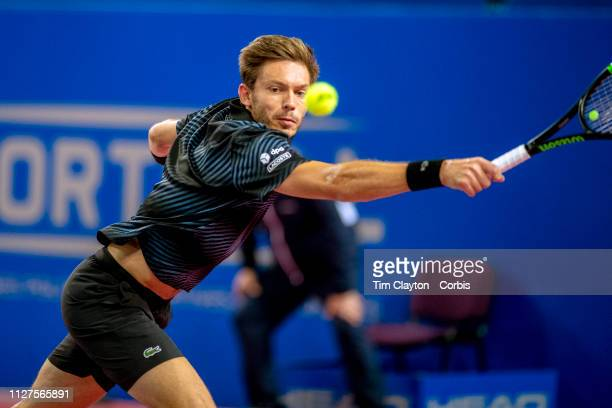 Nicolas Mahut of France in action against Filip Krajinovic of Serbia during the Open Sud de France Tennis Tournament at the Sud de France Arena on...