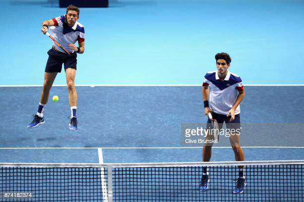 Nicolas Mahut of France partner of PierreHugues Herbert of France returns the ball during the doubles match against Ryan Harrison of The United...
