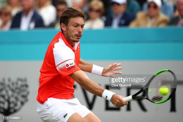 Nicolas Mahut of France plays a backhand during his Second Round Singles Match against Stan Wawrinka of Switzerland during day Four of the Fever-Tree...