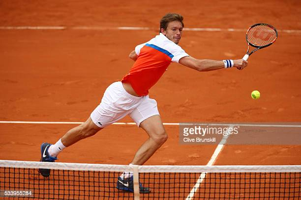 Nicolas Mahut of France plays a backhand during the Men's Singles first round match against Ricardas Berankis of Lithuania on day three of the 2016...