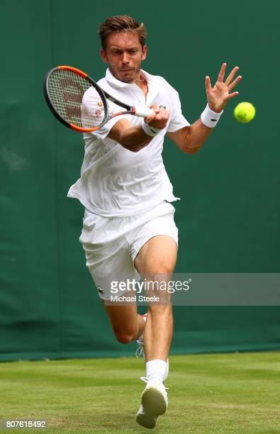 Nicolas Mahut of France plays a forehand during the Gentlemen's Singles first round match against Mikhail Youzhny of Russia on day two of the...