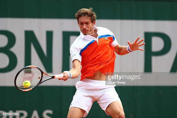 Nicolas Mahut of France plays a forehand during the Men's Singles first round match against Ricardas Berankis of Lithuania on day three of the 2016...
