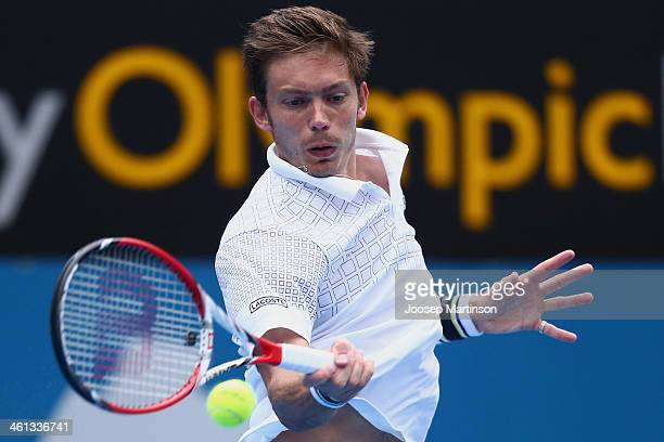 Nicolas Mahut of France plays a forehand in his quarter final match against Juan Martin Del Potro during day four of the 2014 Sydney International at...