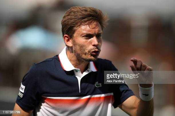 Nicolas Mahut of France reacts to a line call during his Quarter-Final Singles Match against Gilles Simon of France during day Five of the Fever-Tree...