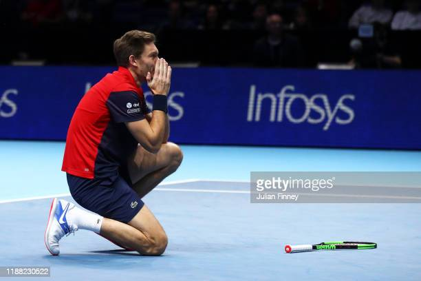 Nicolas Mahut, playing partner of Pierre-Hugues Herbert of France celebrates championship point in his doubles final match against Raven Klaasen of...