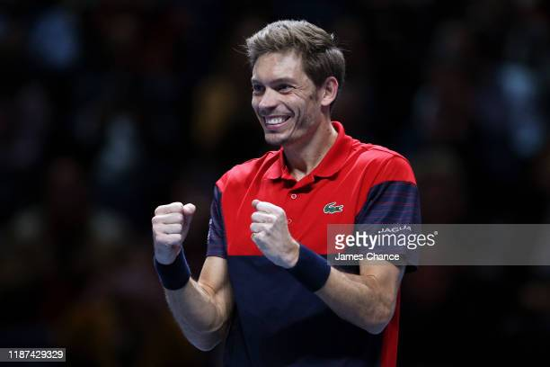 Nicolas Mahut, playing partner of Pierre-Hugues Herbert of France celebrates victory after his doubles match against Kevin Krawietz of Germany and...