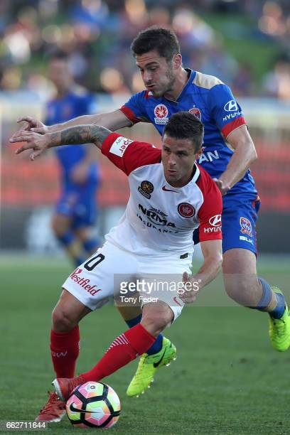 Nicolas Martinez of the Wanderers controls the ball from Mateo Poljak of the Jets during the round 25 ALeague match between the Newcastle Jets and...
