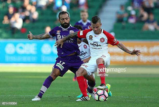 Nicolas Martinez of the Wanderers holds off Diego Castro of the Glory during the round five ALeague match between the Perth Glory and the Western...