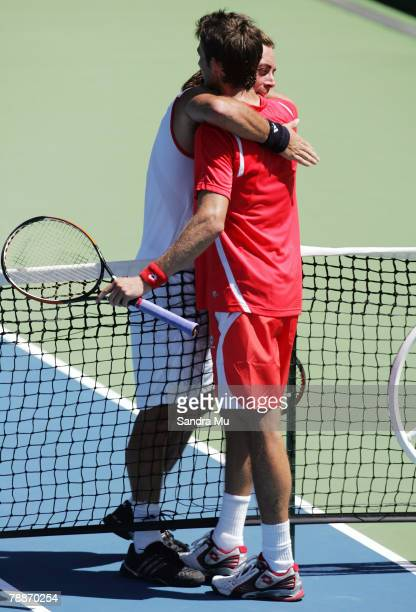 Nicolas Massu of Chile congratulates Juan Carlos Ferrero of Spain at the end of their match during day four of the Heineken Open at the ASB Bank...