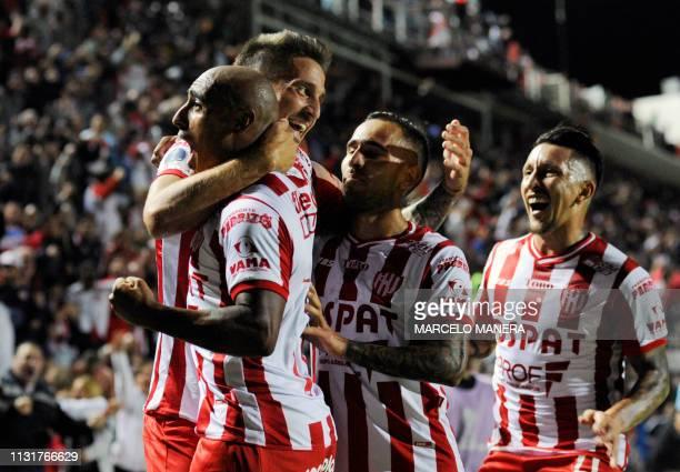 Nicolas Mazzola of Argentina's Union de Santa Fe celebrates with teammates after scoring against Ecuador's Independiente del Valle during their Copa...